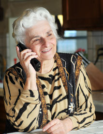 picture of beautiful senior woman  - Portrait of a senior woman talking on the phone - JPG