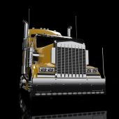 stock photo of freightliner  - Yellow heavy truck isolated on black background - JPG