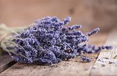 stock photo of lavender plant  - Bunch of lavender flowers on an old wood table - JPG