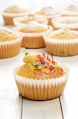 image of bakeshop  - Delicious homemade muffins over white wooden board - JPG