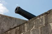 stock photo of artillery  - Barrel of a historic artillery piece at Fort Montagu Nassau Bahamas - JPG