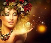 foto of gold-dust  - Christmas Winter Woman with Miracle in Her Hand - JPG