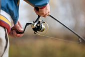 stock photo of fly rod  - Closeup of Fisherman - JPG