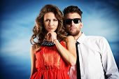 foto of enamored  - Beautiful romantic couple in love standing over blue sky - JPG