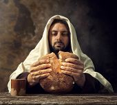stock photo of priest  - The Last Supper Jesus breaks the bread - JPG