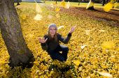 Women In Park Surrounded By Autumn Leaves, New Zealand