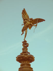 stock photo of ero  - Vintage look Piccadilly Circus with statue of Anteros aka Eros in London UK - JPG