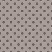 Seamless vector pattern or tile texture for background with brown polka dots on beige background.
