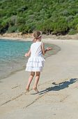 stock photo of hopscotch  - Little girl playing hopscotch game on the beach - JPG