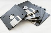 foto of outdated  - Pile of black blank floppy disks closeup - JPG