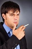 Young Businessman During A Break  Smoking A Cigarette