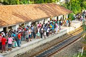 Bentota, Sri Lanka - 28 Apr 2013: People Wait For A Train On Railway Platform In Bentota, Sri Lanka.