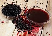 stock photo of elderberry  - Black elderberry fruit herb on the table