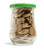 Coins in a glass jar against a white background