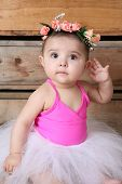 pic of bodysuit  - Baby ballerina wearing a white tutu and pink bodysuit