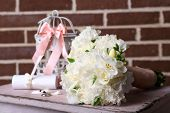 Beautiful wedding still life with  bouquet on bricks wall background