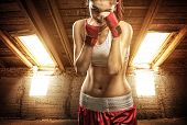 image of attic  - Young women boxing exercise in the attic - JPG