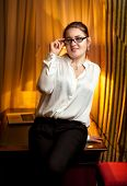 Businesswoman In Eyeglasses And White Blouse
