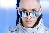 Portrait of the eccentric futuristic man in silver costume. Innovations and high technology. Rock ar