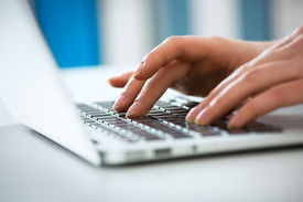 pic of keypad  - Closeup of businesswoman typing on laptop computer - JPG