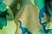 stock photo of camoflage  - a fabric with pattern of camouflage background - JPG