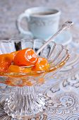 foto of kumquat  - Jam from the whole kumquats lies in a glass vase - JPG