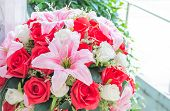 stock photo of lilly  - fake beautiful plastic Lilly and rose flower - JPG