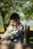 stock photo of spring lambs  - little boy with lamb on the farm - JPG