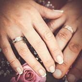 picture of marriage ceremony  - Hands and rings on wedding bouquet - JPG