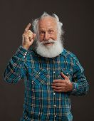 stock photo of insane  - old man with a long beard with big smile on a dark background - JPG