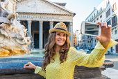 image of selfie  - Young woman making selfie near fountain of the pantheon in rome italy - JPG
