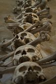 stock photo of eye-sockets  - old bones and skulls in the Gothic vault of Kutna Hora. Ossuary. ** Note: Visible grain at 100%, best at smaller sizes - JPG