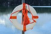 stock photo of fjord  - life buoy on the norwegian fjord or on alpine lake - JPG