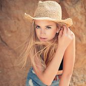 picture of short legs  - Beautiful young woman in straw hat and jeans shorts on the beach - JPG
