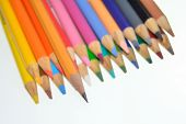 stock photo of pencils  - A number 2 pencil rests atop and protrudes over colored pencils  - JPG