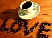 stock photo of coffee crop  - LOVE COFFEE made of coffee beans and espresso cup - JPG