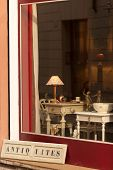 image of local shop  - Window display of antiques shop in Verona - JPG