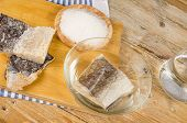 stock photo of cod  - Several pieces of dried cod being desalted in fresh water  - JPG