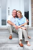 image of retirement age  - Senior couple at new home - JPG