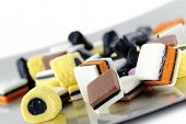stock photo of trays  - colorful liquorice candies on tray on white background - JPG