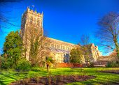 picture of church-of-england  - Christchurch Priory Dorset England UK 11th century Grade I listed church in town centre in vivid colourful HDR like painting - JPG