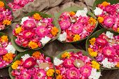 foto of camphor  - Flowers arranged with clay lamps for offering to Hindu gods - JPG