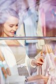 image of boutique  - Beautiful young woman in boutique - JPG