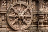 stock photo of chariot  - A chariot wheel carved into the wall of the sun temple at Konark - JPG