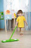 foto of training room  - kid boy cleaning room - JPG