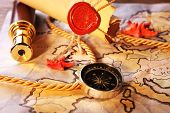foto of spyglass  - Marine still life with world map and spyglass on wooden table background - JPG
