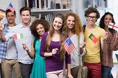 pic of waving  - Happy students waving international flags at the college - JPG