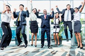 stock photo of diversity  - Diversity business team jumping celebrating success - JPG