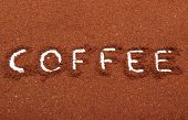 picture of coffee grounds  - Word coffee written on ground coffee ground coffee with word coffee - JPG