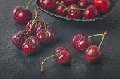 picture of black-cherry  - Sweet cherry fruit with water drops on black stone background - JPG